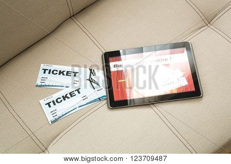 Buy cinema Tickets online with your mobile device or Tablet PC on the sofa.