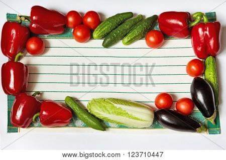 Frame from ripe vegetables on towel perimeter