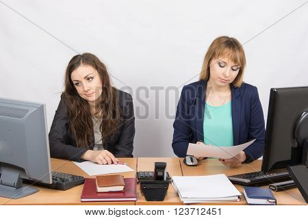Office Workers Of Despondently Sitting At A Desk