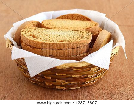 Healthy snack fresh rusk, a type of bread, made from whole-wheat flour, on a wooden table.