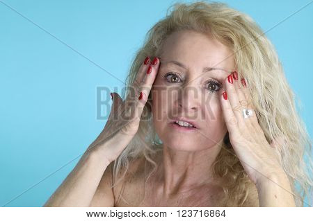 anti wrinkle - mature woman touching her skin