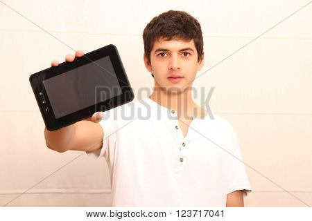 A young latin man with a Tablet PC face in focus ** Note: Shallow depth of field
