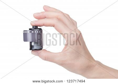 female hand holding a film for the camera over white