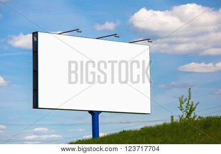 Blank billboard on blue sky background. Street poster. For design presentations and portfolios.