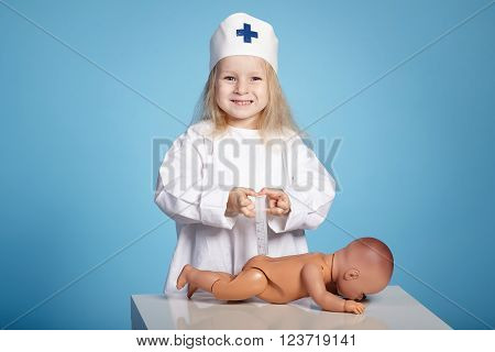 photo of little funny girl playing nurse