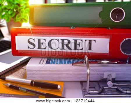 Secret - Red Ring Binder on Office Desktop with Office Supplies and Modern Laptop. Secret Business Concept on Blurred Background. Secret - Toned Illustration. 3D Render.