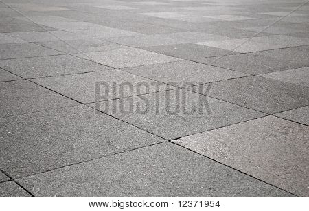 Rough texture of wet block pavement