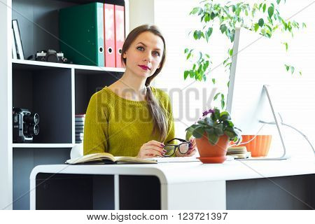 Beautiful young woman working from home - modern business concept