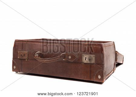 old leather suitcase isolated in white background