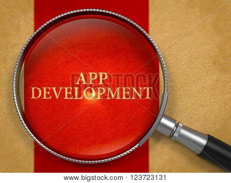 App Development through Loupe on Old Paper with Crimson Vertical Line Background. 3D Render.