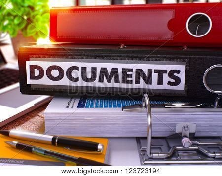 Black Office Folder with Inscription Documents on Office Desktop with Office Supplies and Modern Laptop. Documents Business Concept on Blurred Background. Documents - Toned Image. 3D.