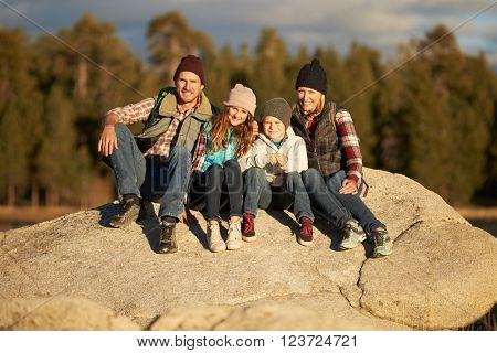 Portrait of Family sitting on rocky outcrop, California, USA