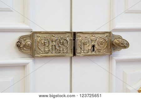 Vintage Gilded Ancient Lock On The White Door