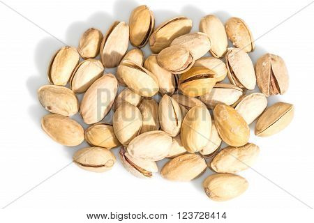 Pistachios on a white background. In this photo we see pistachios on a white background.
