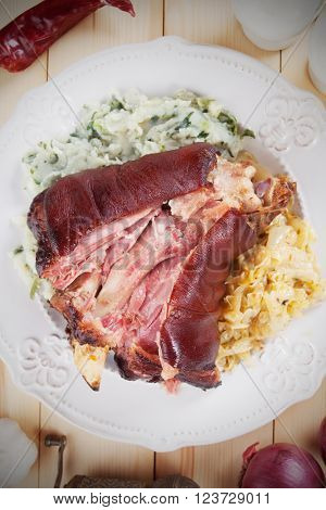 Roasted pork knuckle with sour cabbage and mashed potato