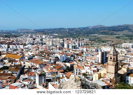 Elevated view over the town rooftops towards the mountains Velez Malaga Costa del Sol Malaga Province Andalusia Spain Western Europe.