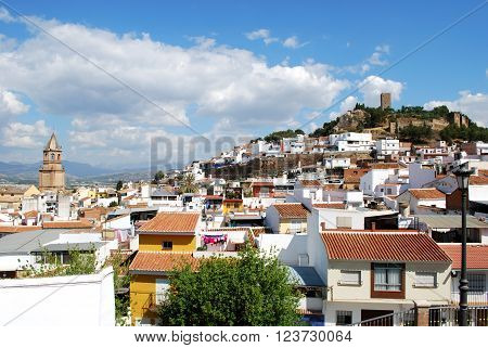 View of church and town rooftops with the castle to the rear Velez Malaga Costa del Sol Malaga Province Andalusia Spain Western Europe.