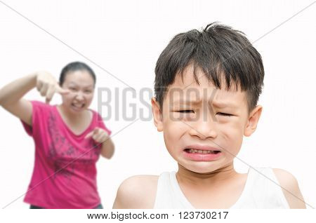 Little Asian boy being scold by his mother