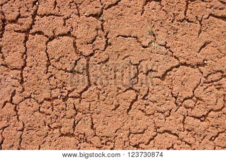 Old Dry Red Crushed Bricks Surface On Outdoor Tennis Ground. Detail Of Texture