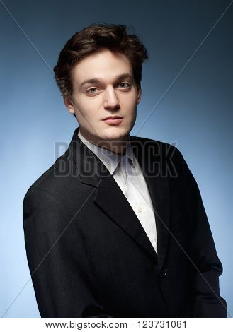 Portrait of a Young Man with Brown Hair in Suit.