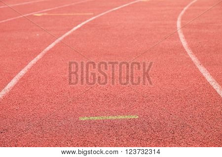 White lines and texture of running racetrack, red rubber racetracks in outdoor stadium