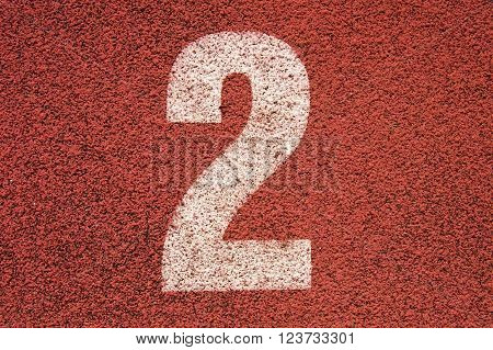White Track Number On Red Rubber Racetrack, Texture Of Running Racetracks In Small Outdoor Stadium