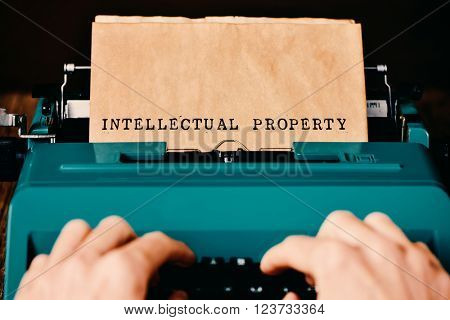 the text intellectual property written in a yellowish paper with a retro typewriter