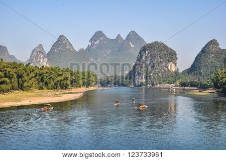 Picturesque banks of the river on a mountains background.