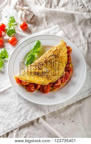 Rustic omelet with tomato simple photo on white napkin