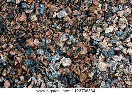 Pattern of the dark gravel surface. Texture of wet gravel