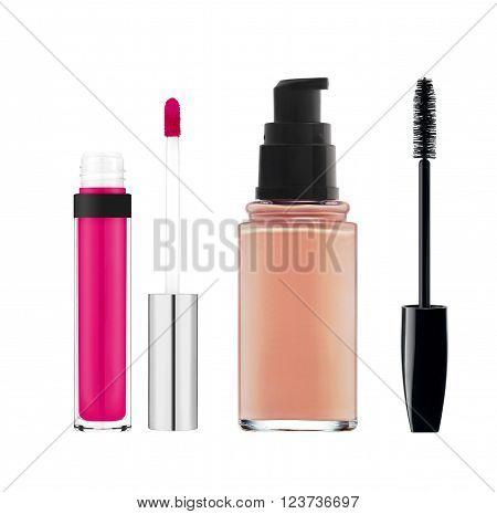 foundation mascara lipgloss isolated on white background