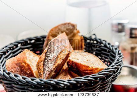 bread in basket - little roll breads in basket on table.