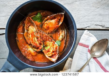Nezealand Mussels in Tomato and herbs sauce in a saucepan