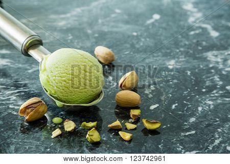 Pictachio ice cream in scoop, copy space