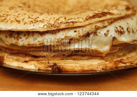Close up of a pancakes pile with copy-space on the top