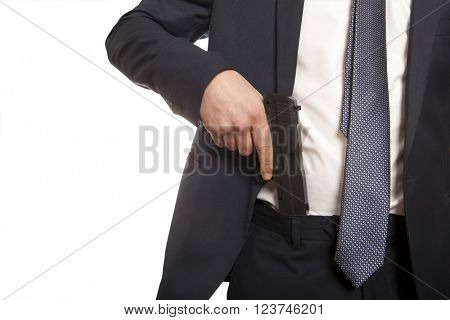 Businessman in a suit holding a gun