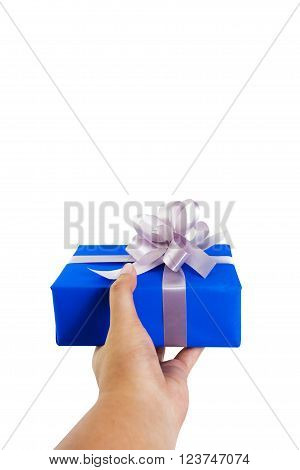 hand gesture giving a gift wrapped in blue box with silver ribbon and bow in a first person view. isolated on white background