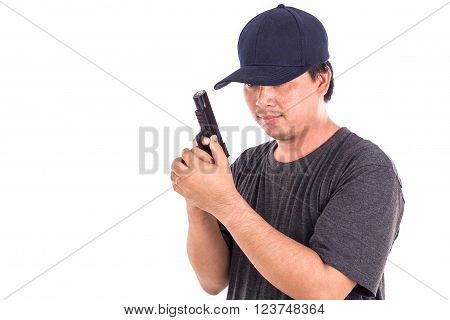 Portrait Of Asian Man Holding Gun Isolated On White