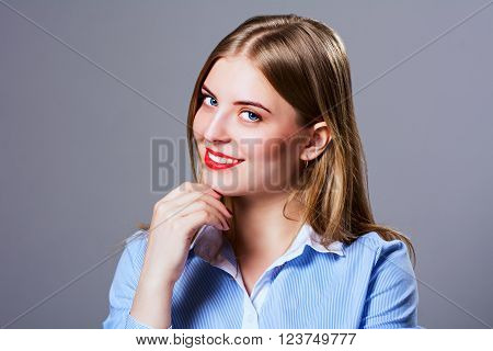 Close-up portrait of beautiful girl. Sensual woman in a shirt with straight hair looking at the camera.