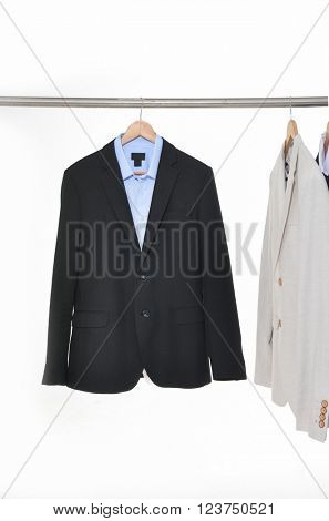 shot of business man suit clothes hanging