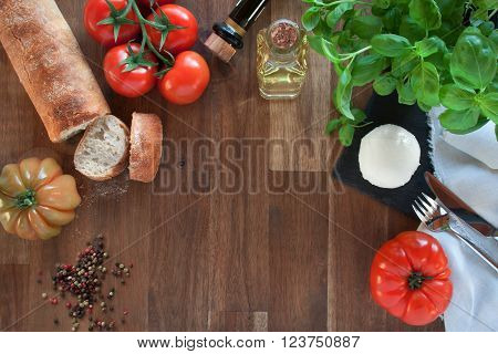 Fresh ingredients for mozzarella with different tomatoes and ciabatta