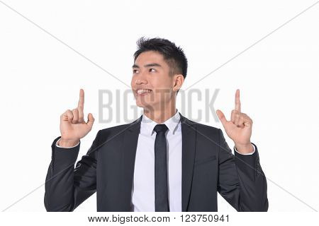 Isolated young business man in suit pointing
