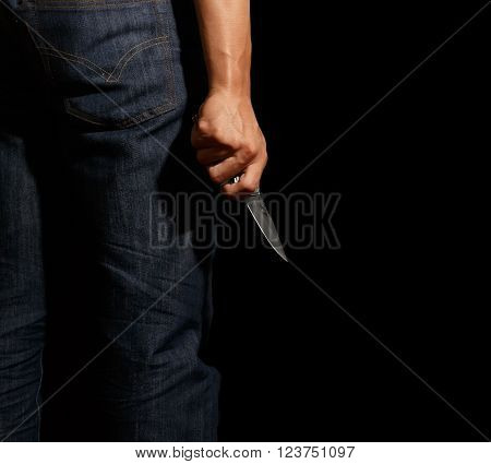 Man hold knife in right hand, isolation on black background