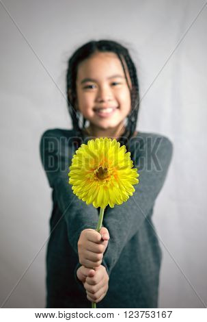 Portrait Of Young Cute Girl With Sunflower