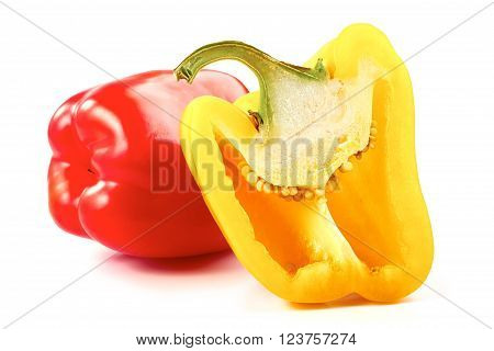 Red and half of yellow bell peppers isolated on a white background