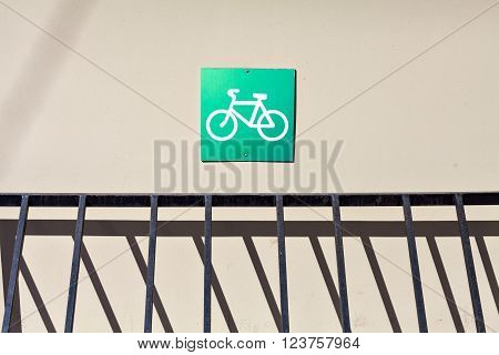 Empty Bicycle parking with the sign. Green sign bicycle parking on the wall