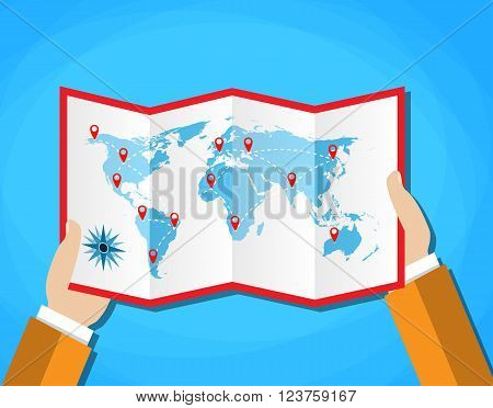 Cartoon hands hold folded paper map of world with color point markers. World map countries. vector illustration in flat design on blue background