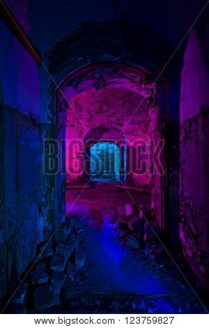 Abstract colorful light painting in abandoned soviet bunker. Pink and blue bright lights inside seedy arc