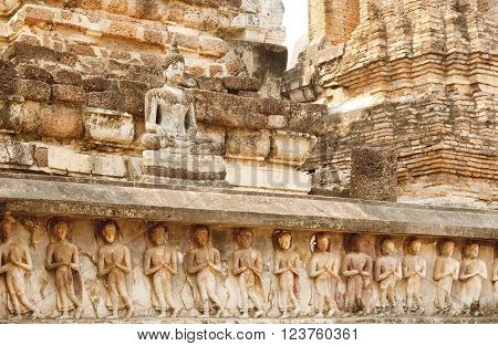 SUKHOTHAI, THAILAND - FEB 16: Sculptures carved temple walls and body of Buddha at Sukhothai historical park on February 16, 2015. Sukhothai historical park is a UNESCO World Heritage Site.