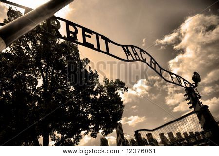 Auschwitz gate entrance. Old style photo of Auschwitz camp